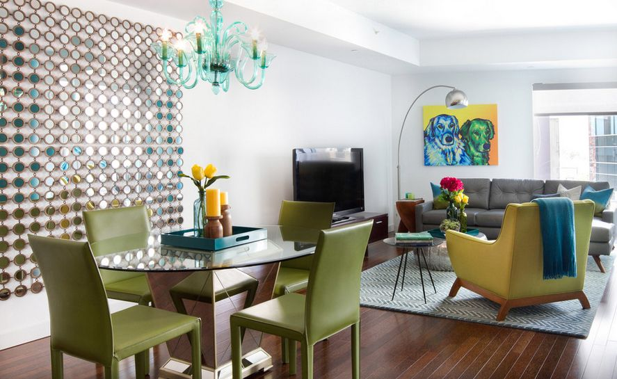 Residence with green leather furniture and round glass dining table