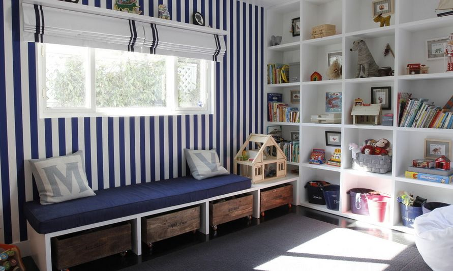 Striped walls and different storage system for playroom & Kid-Friendly Playroom Storage Ideas You Should implement