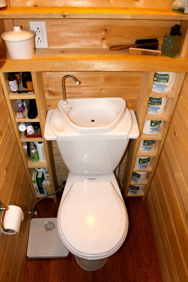 Tiny house cabine featuring a toilet sink combo