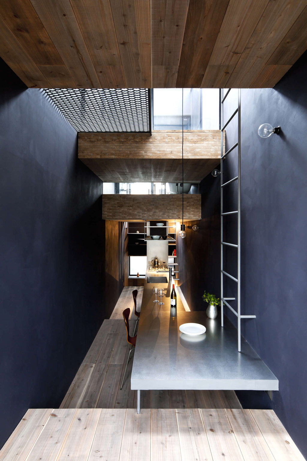 Long And Narrow House Squeezed Between Two Buildings