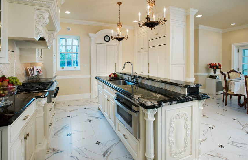 Traditional white kitchen with marble black countertop