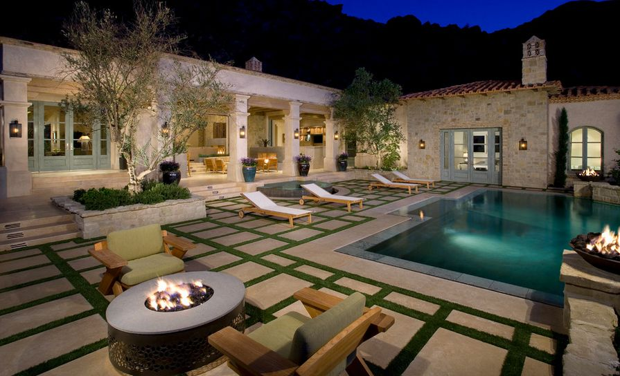 grass-and-concrete-pavers-around-pool
