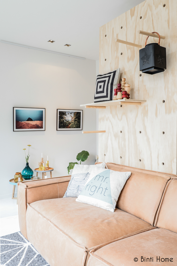oversized-pegboard-wall-behind-sofa