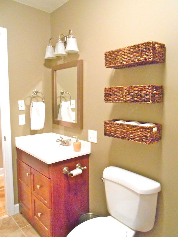 Rattan Baskets Above The Toilet