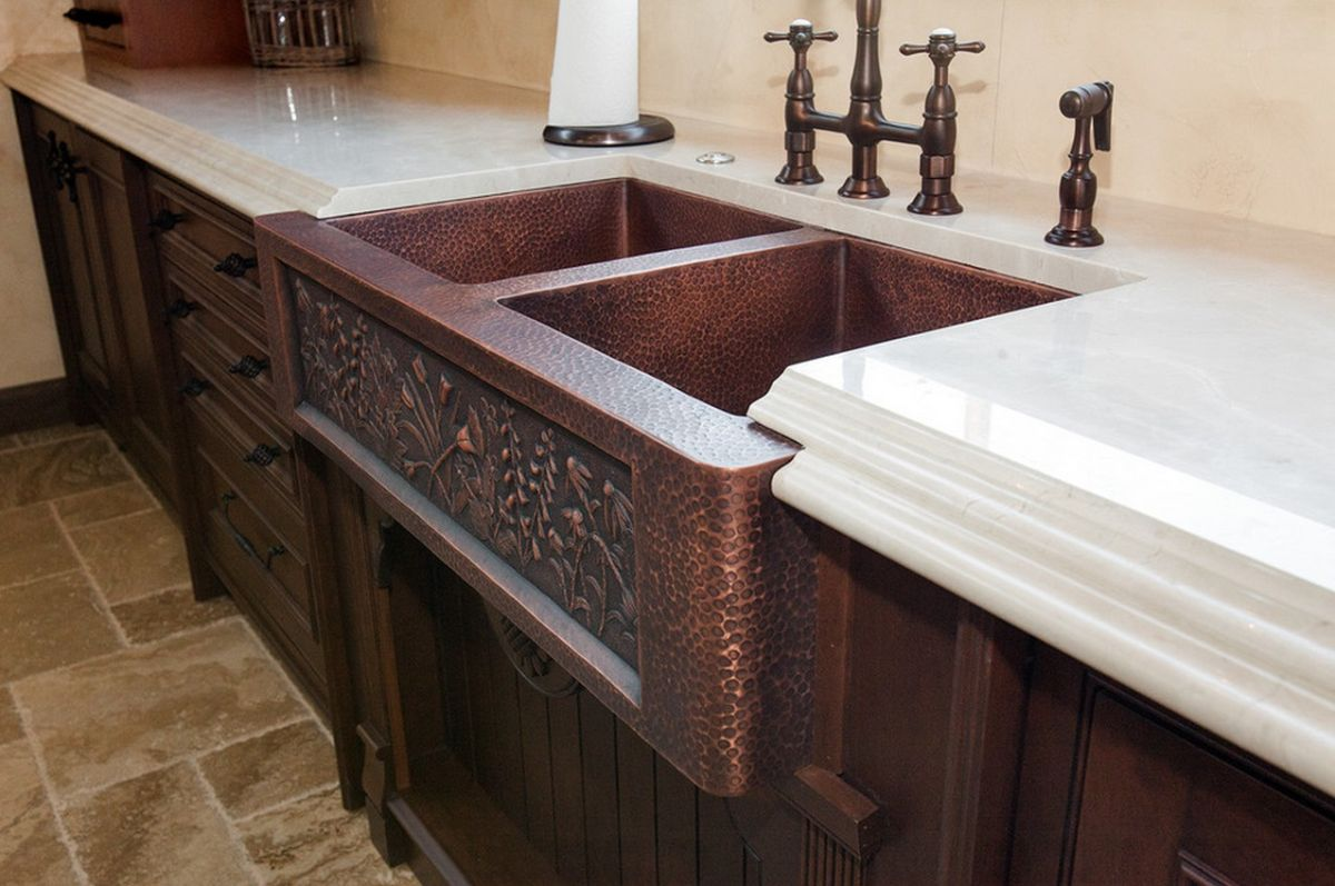 vine-design-on-copper-sink