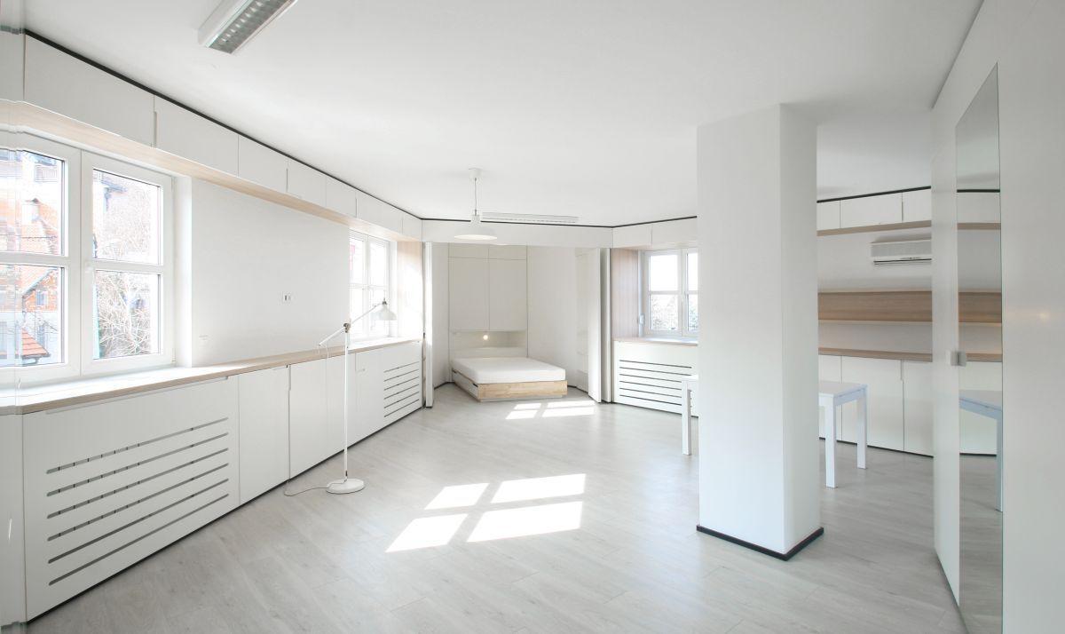 A Custom Design Makes The Most Of An Irregular Apartment Floor Plan