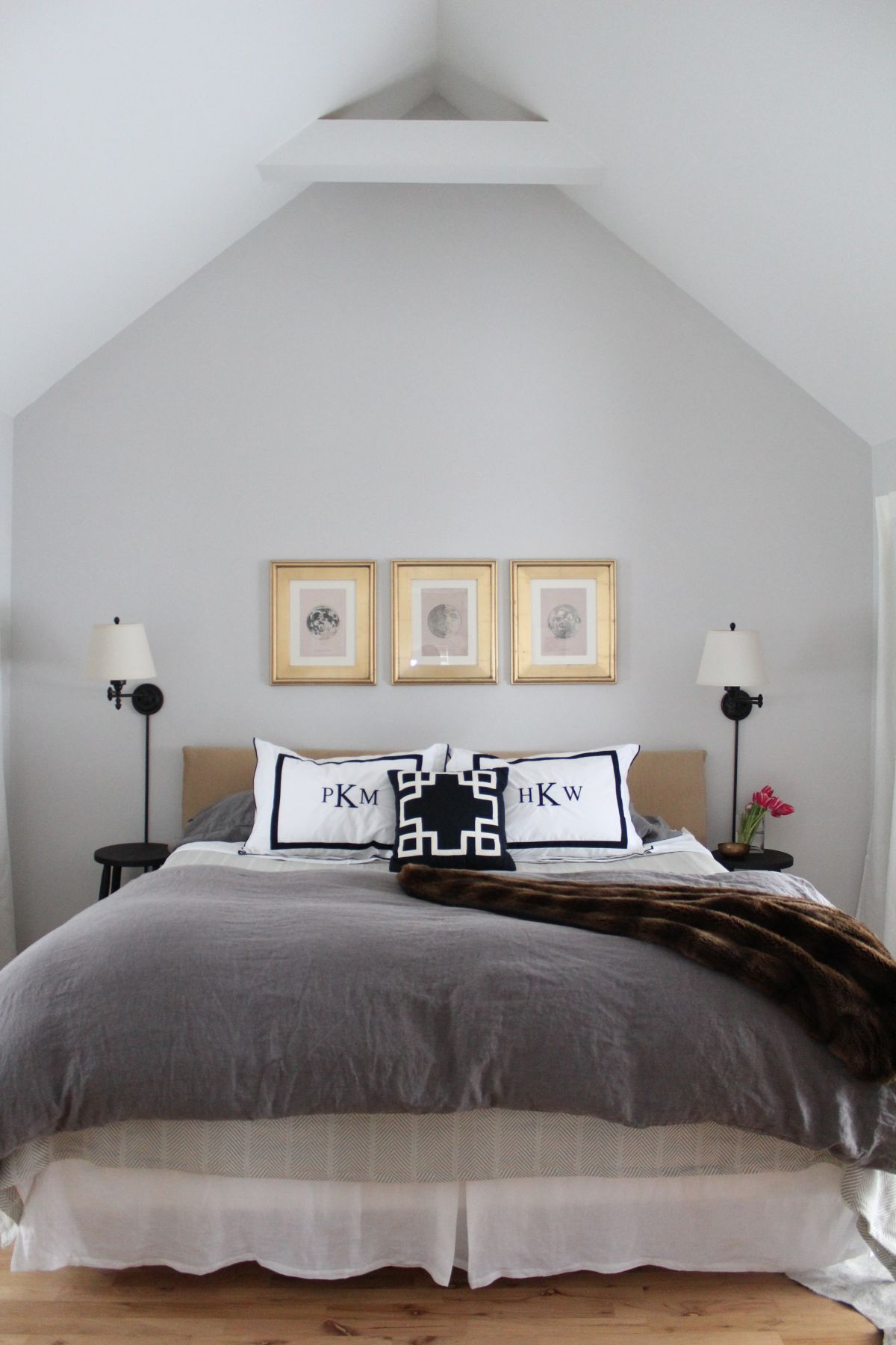 how to use neutral colors without being boring a room by 12698 | attic bedroom with black and white pillows