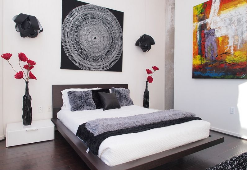 Bedroom walls decorated with canvas art