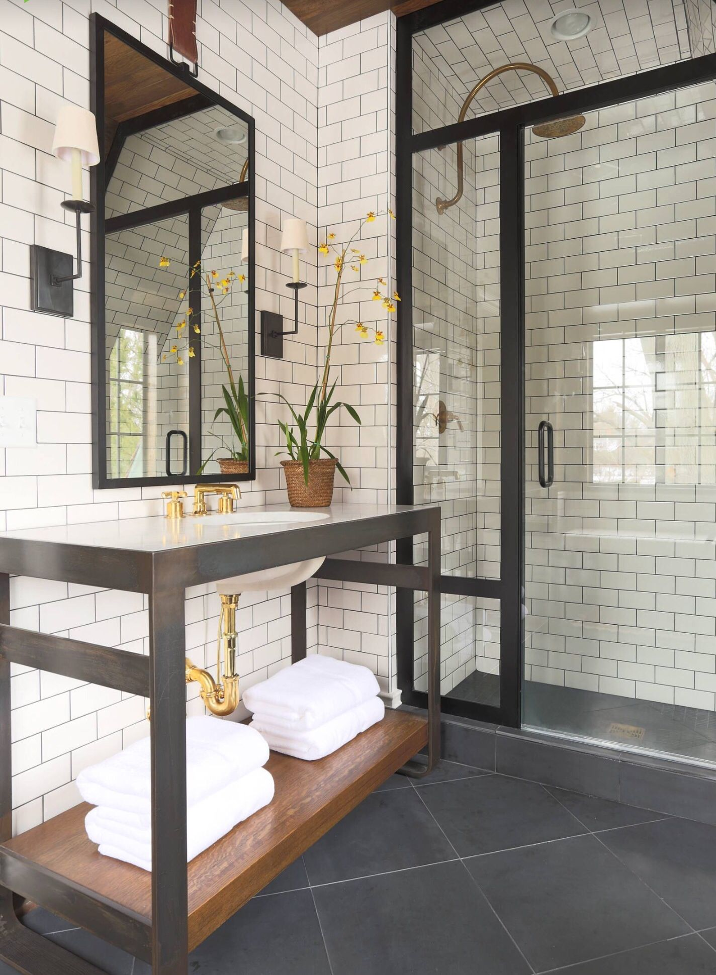 Black Framed Bathroom With Subway Tiles