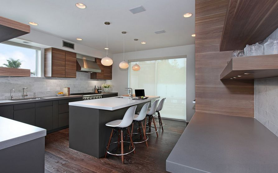 Brown wood kitchen design with plastic molded bar stools
