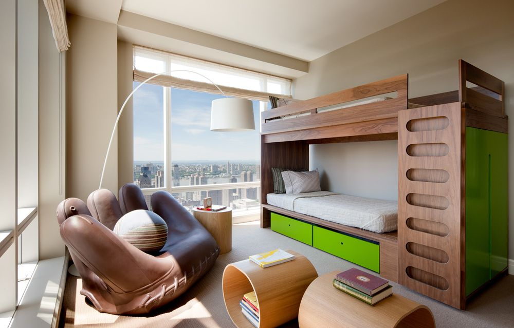 Whimsical and functional without being childish, the boy's bedroom is equipped with spaces for play as well as relaxation.