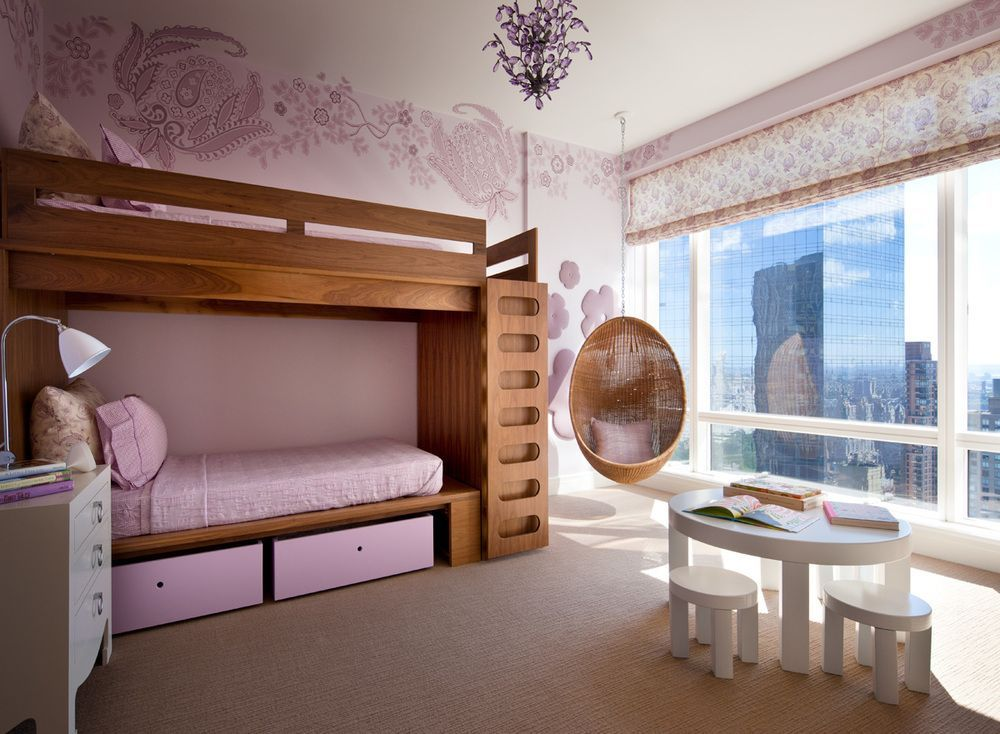 What little girl wouldn't love the calm colors and fun hanging chair in this bedroom?