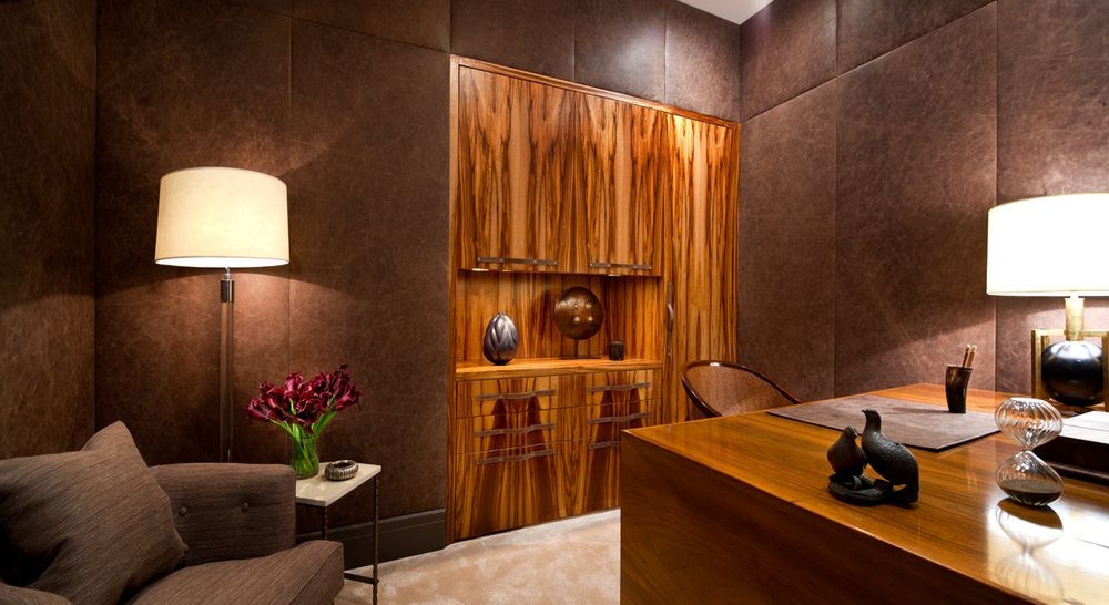 The fascinating grain of the wood cabinetry is the focal point of the home's office. Again the textures of the wood, walls and sofa keep the neutral palette visually engaging.