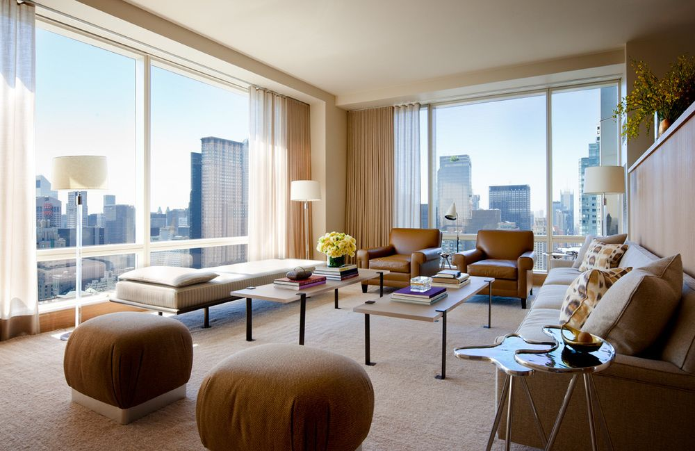 Designing Home Interiors For His Clients Rather Than Compete With The View Room Showcases City Beyond Stunning Floor