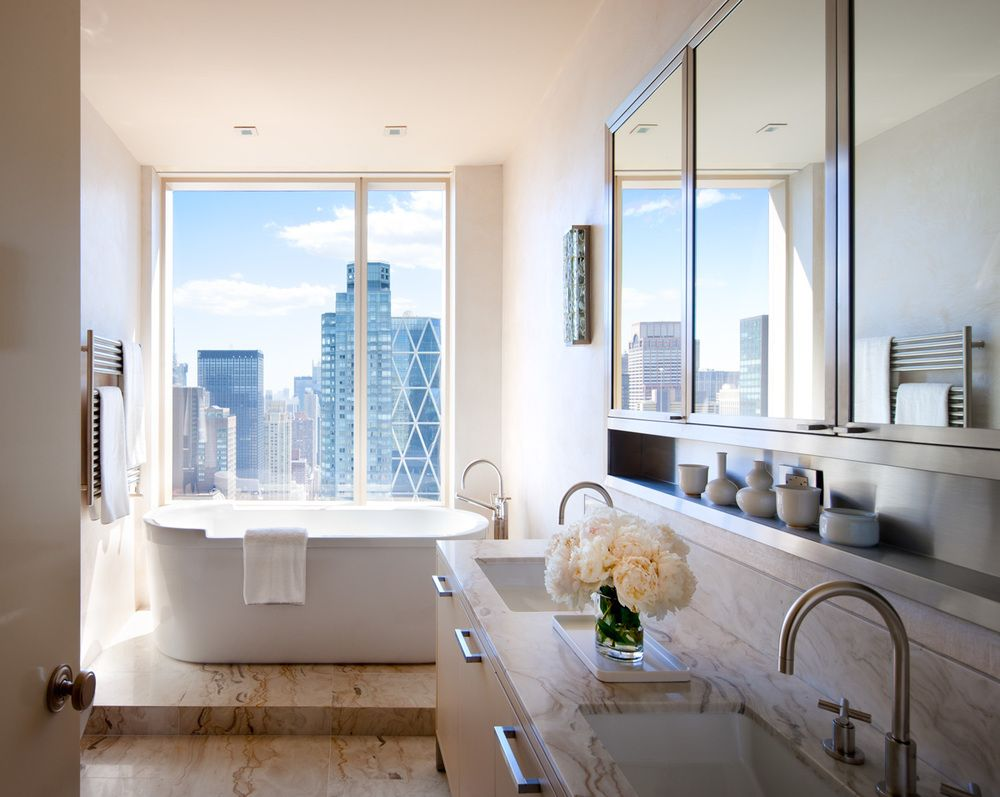 The stunning master bathroom of the Central Park home is relaxing as well as supremely functional, again taking advantage of the spectacular view.