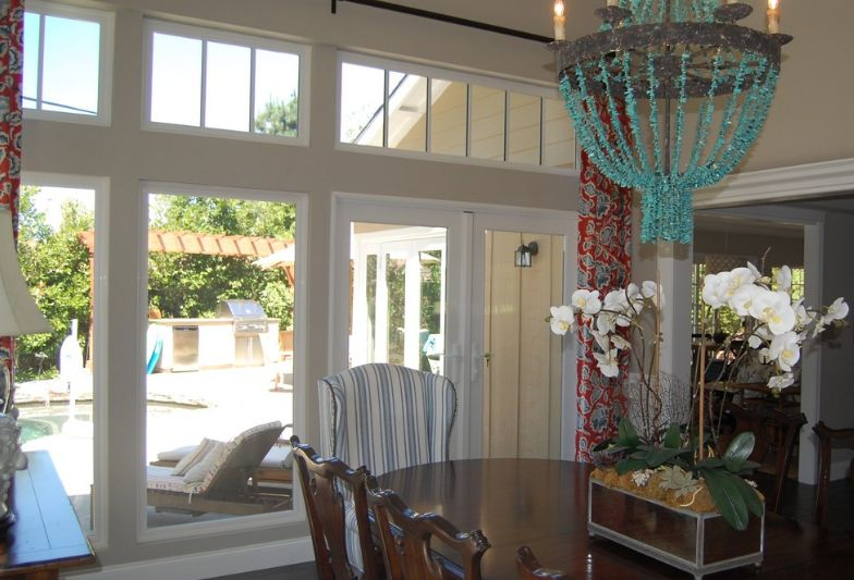 Chandelier with beaded design over dining table