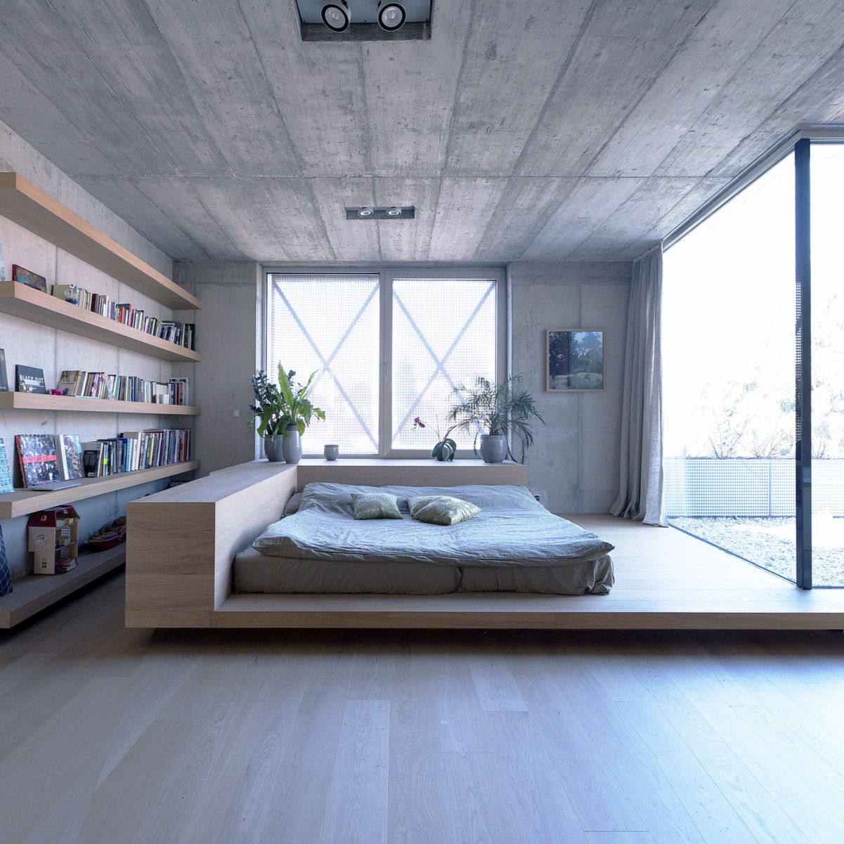 Concrete OFIS Architects Home Library behid bed