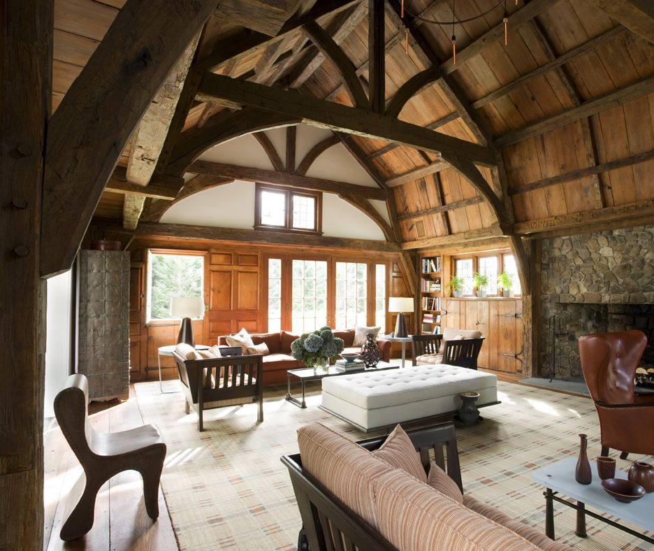 The soaring beamed ceiling of the home providesfor a breathtaking living room design.