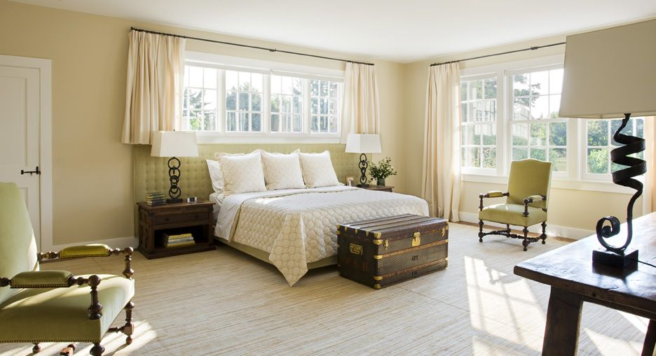 Serene and inviting, the master bedroom plays up the gentle green accent and textures through the room.