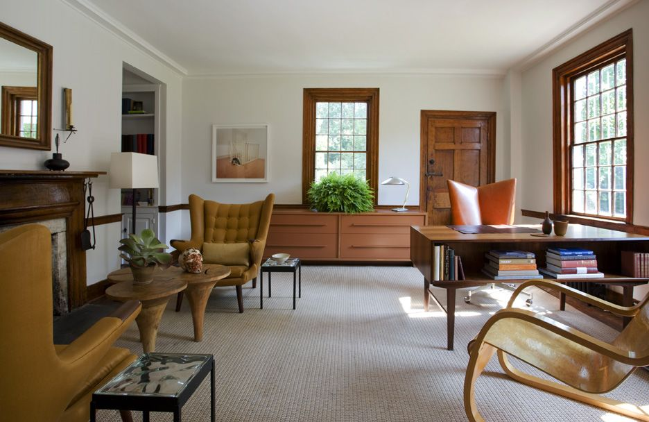 The farmhouse's office uses unique furnishings, such as the eye-catching one-legged conjoined tables.