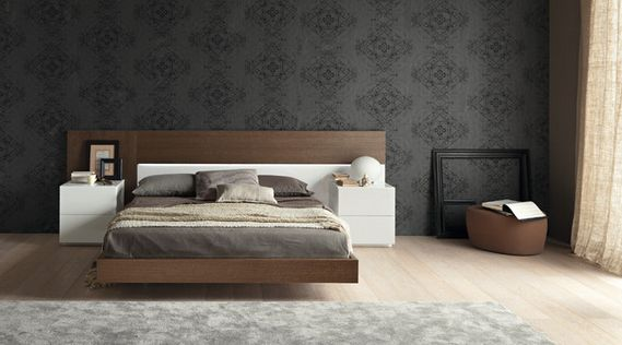 bedroom with platform bed and black wallpaper