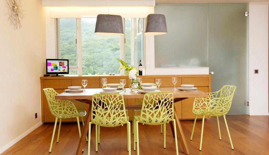 Dining room with yellow chairs and felt lamp over table