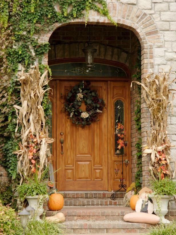 Front door autumn decoration with pumkins