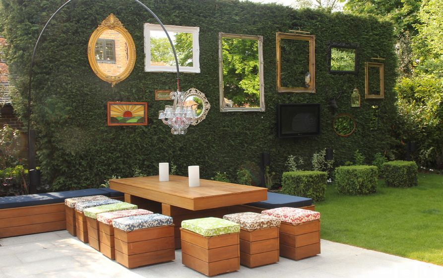 garden wall decoration ideas. Green wall decorated with mirrors and empty frames How To Beautify Your House  Outdoor Wall D cor Ideas