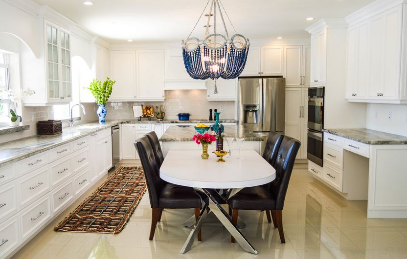 Large kitchen with beaded chandelier over table