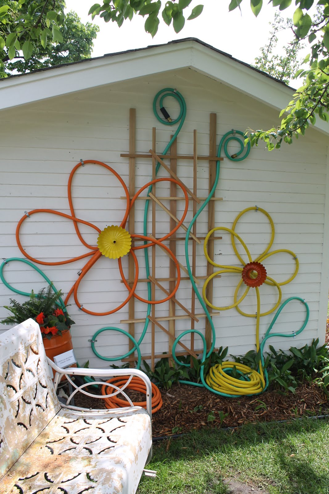 garden wall decoration ideas. Make flowers from hoses for outdoor house decor How To Beautify Your House  Outdoor Wall D cor Ideas