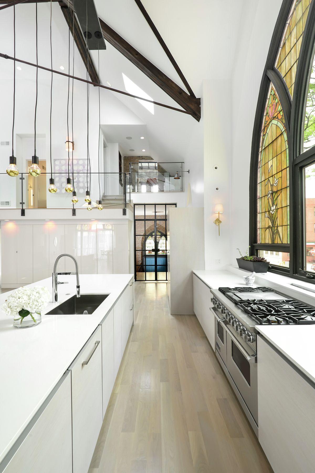 Modern white gallery kitchen in a church