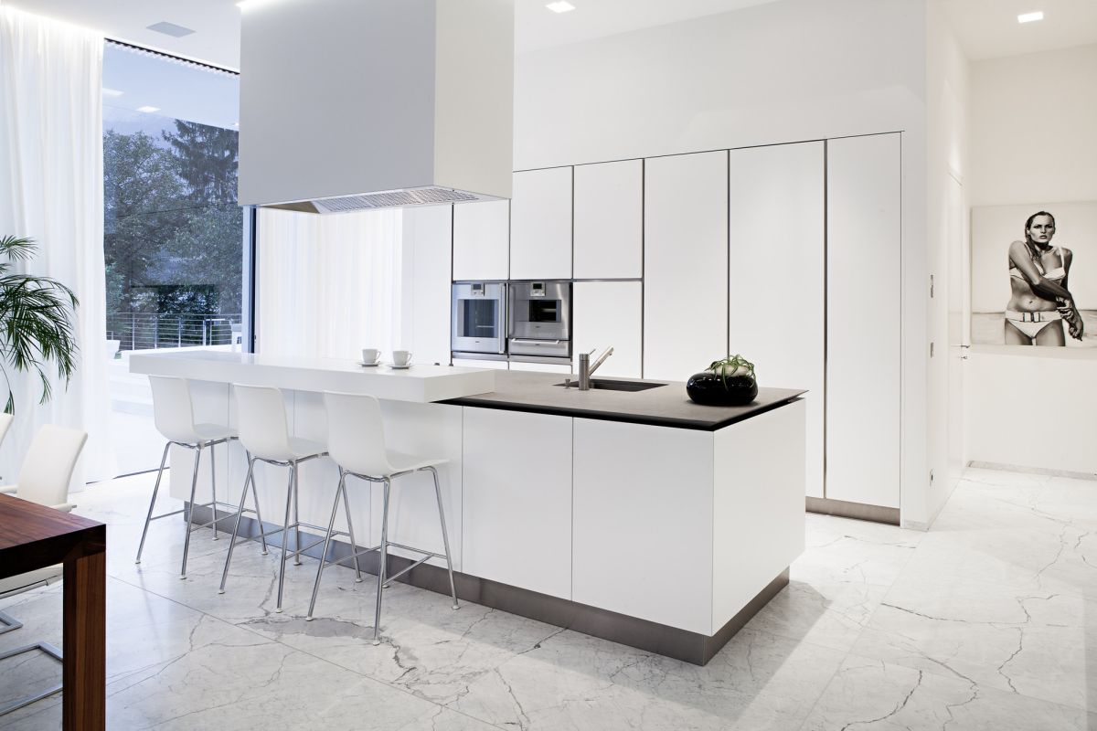 Modern white kitchen with marble floor and large kitchen island