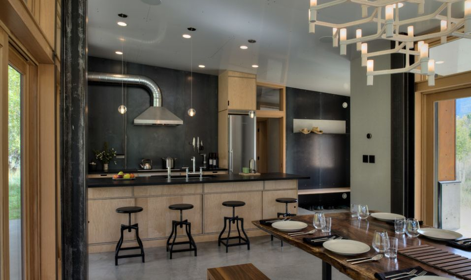 Open floor plan kitchen with black stools