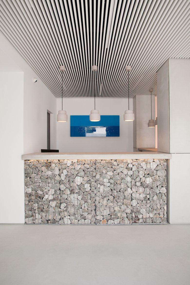 Relux Ios Island Hotel gabion accent wall