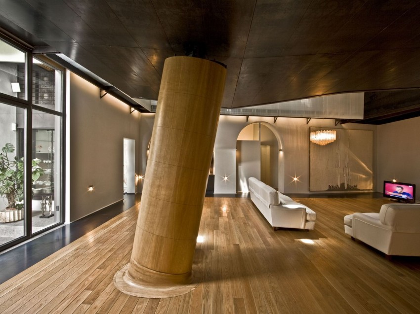 Rome stables converted into loft apartment large column supports sleeping area