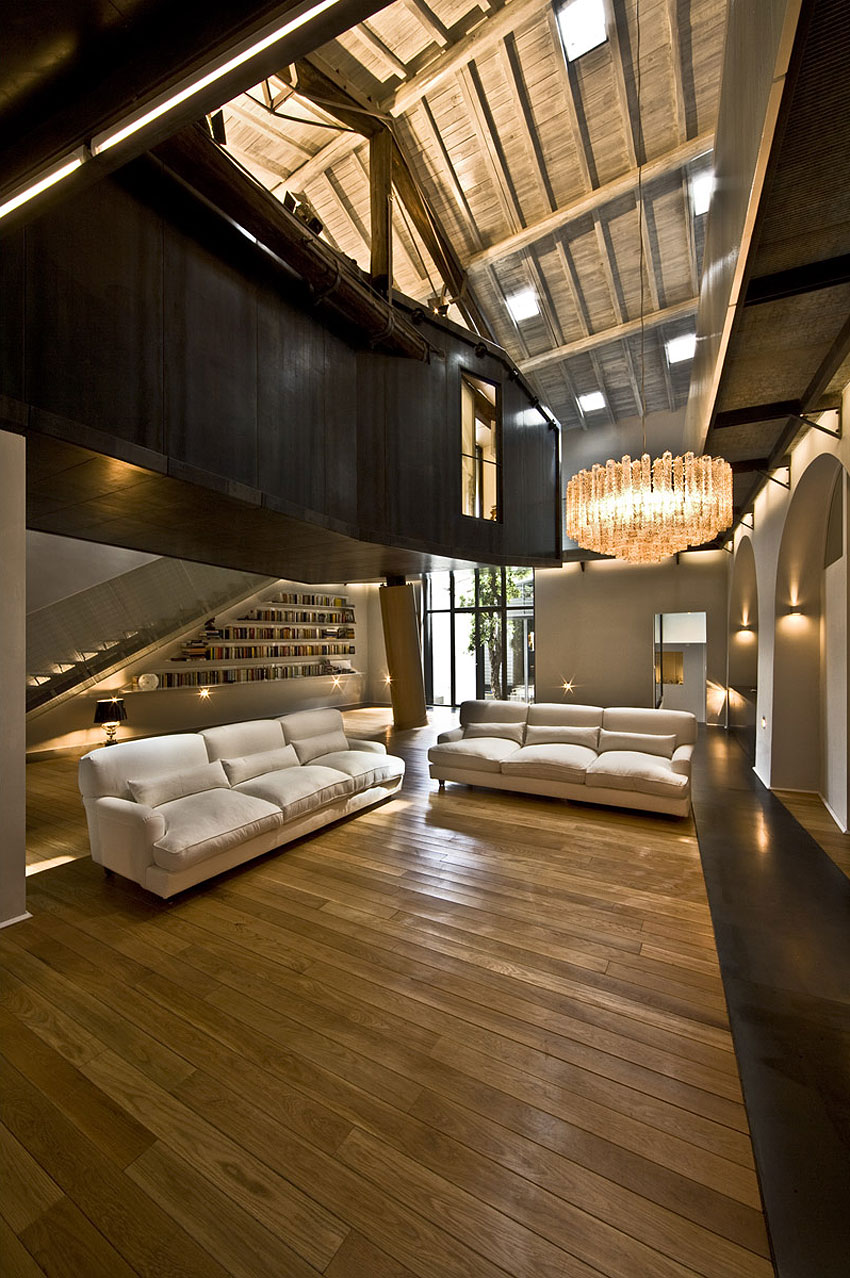Rome stables converted into loft apartment living room chandelier