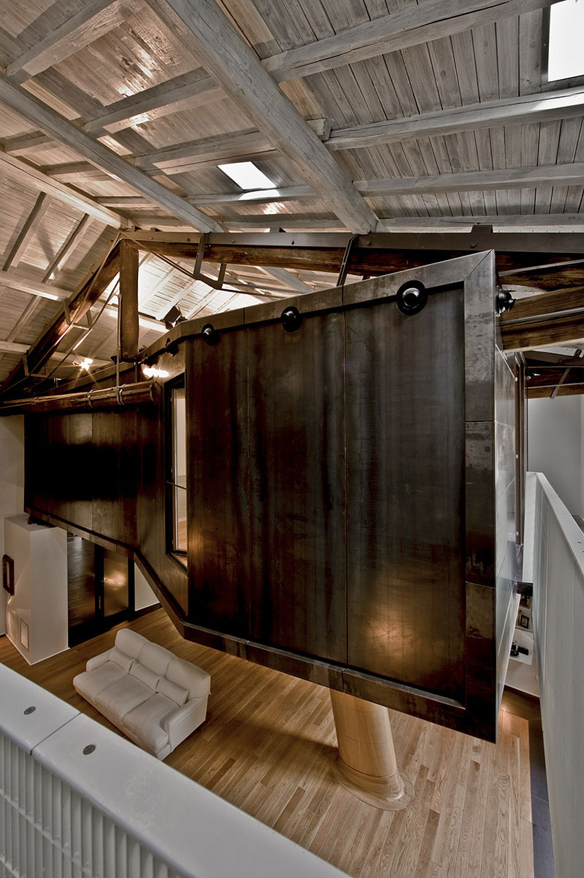 Rome stables converted into loft apartment metal and wood combination