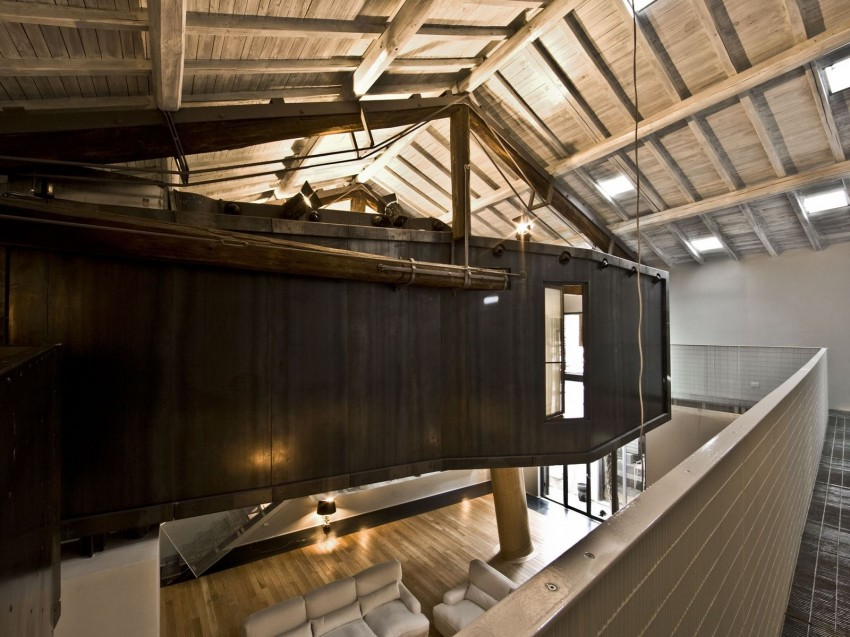 Rome stables converted into loft apartment metal tunnel suspended from roof