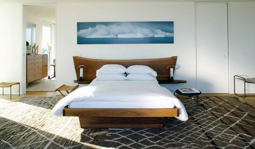 Solid wood bedroom furniture and wall art above it How To Give Character A Bedroom With Painting Over The Bed