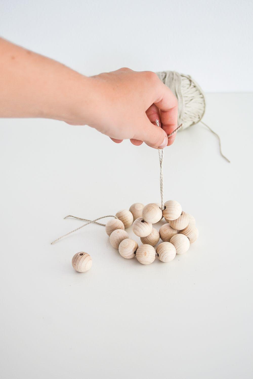 Start stringing the beads smaller