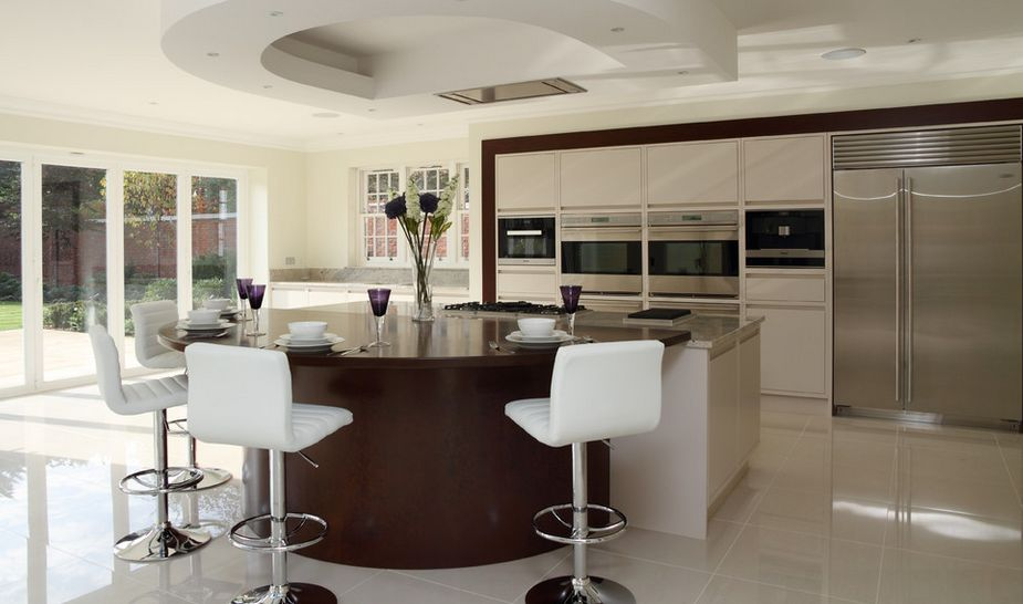 Tall white bar stools for a round kitchen island