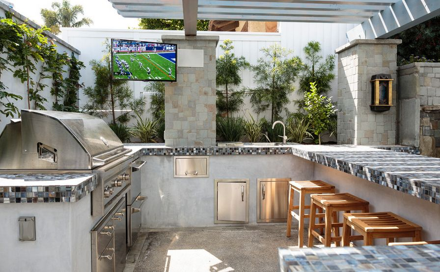 Urban outdoor kitchen with mosaic countertop
