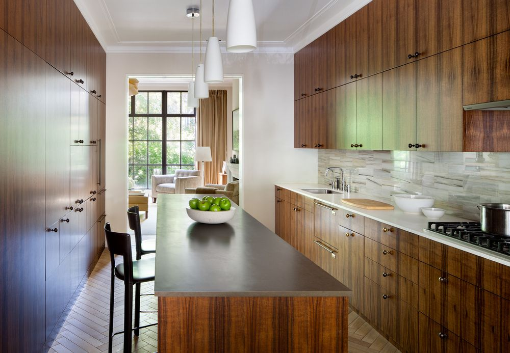 The large kitchen features stunning wood for the cabinetry.