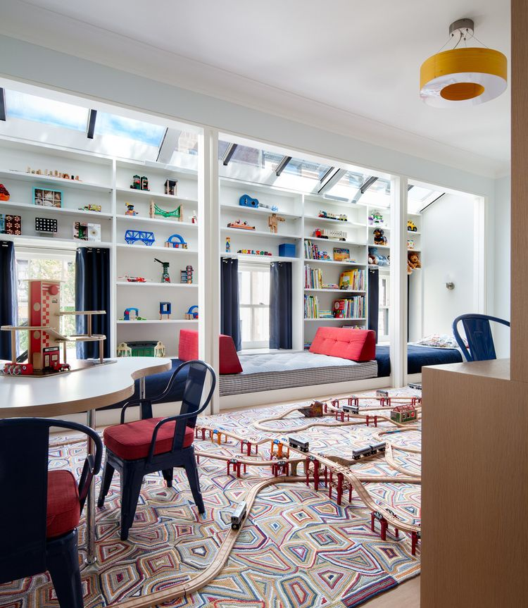 This playroom has more than enough space for imaginative play. The amusing rug is yet another example of how Henderson designs child-centered spaces that are fun but not juvenile.