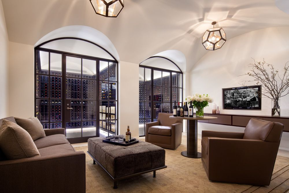 The home's indescribably gorgeous wine cellar and tasting room are inviting, while making the wine collection as special as a piece of art.