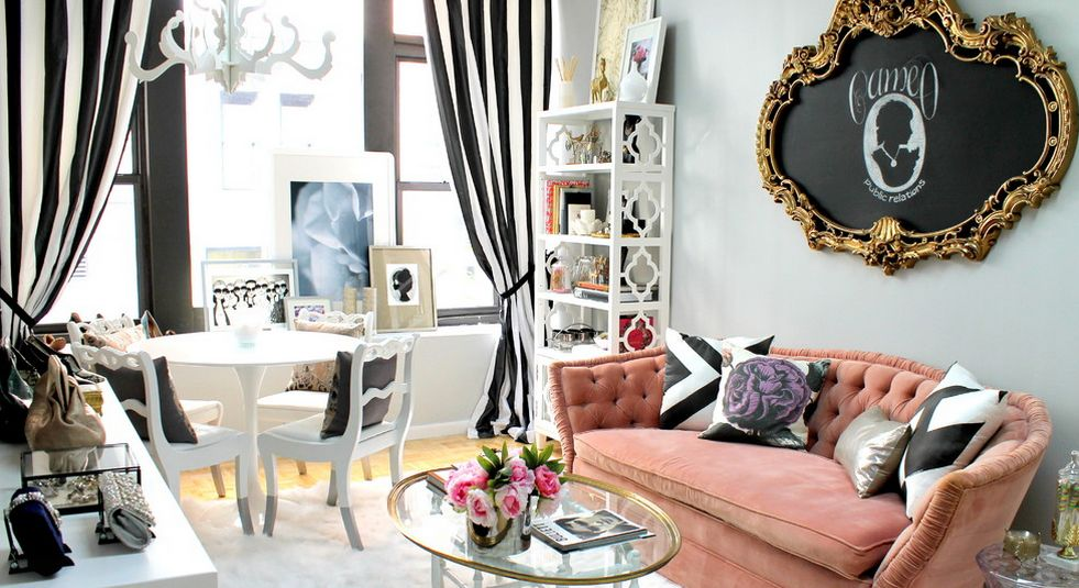 Well decorated living room with pink pale accents and Saarinen Tulip Table
