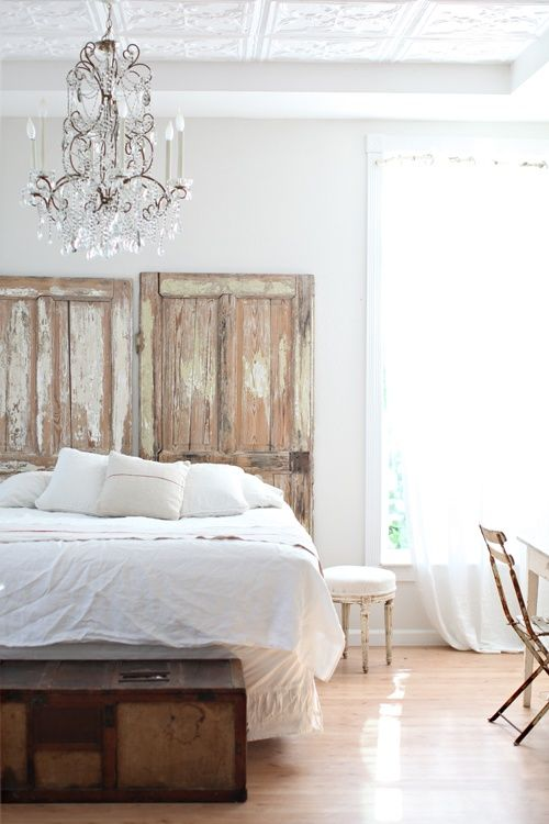 White bedroom with old doors for headboard
