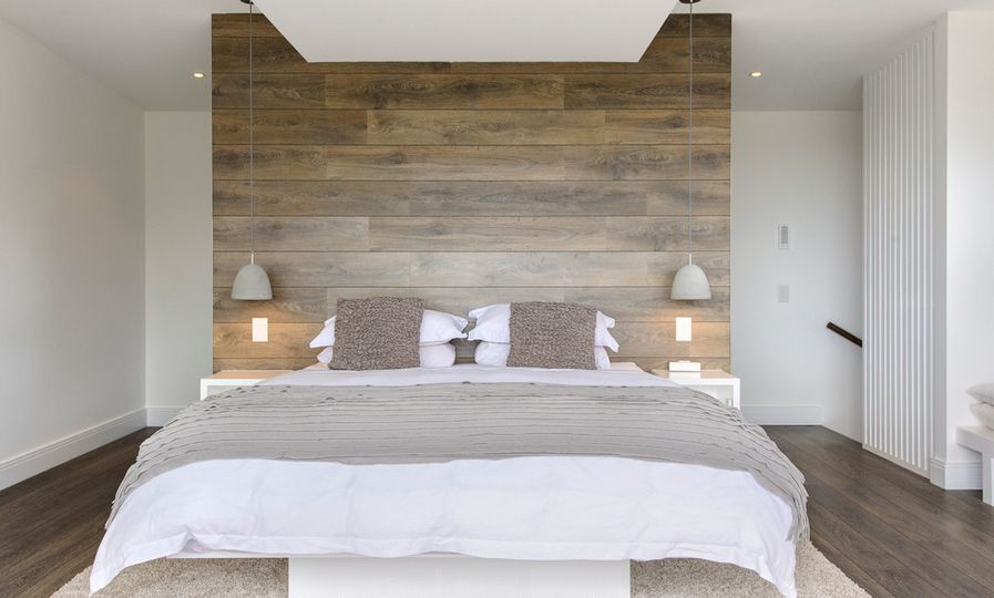 White bedroom with wooden headboard