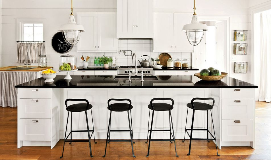 White farmhouse kitchen with black stools