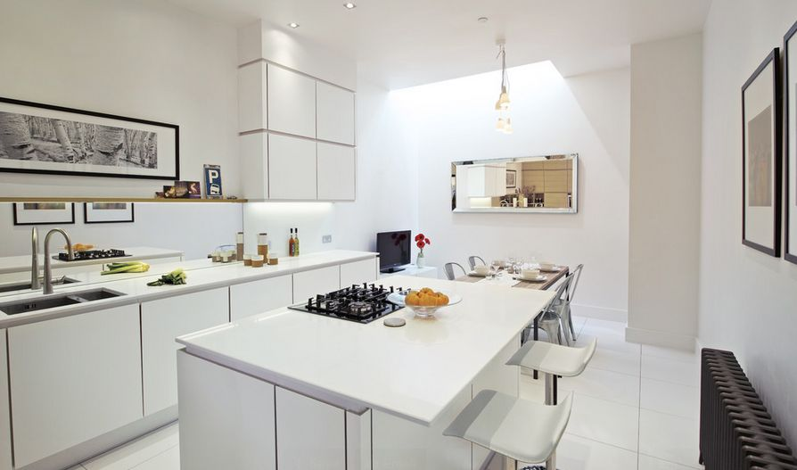 White kitchen design with dining area